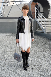 Marina Fois toughened up her demure LWD with a black leather jacket for the Louis Vuitton fashion show.