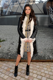 Selena Gomez was retro-fab in a fur-trimmed leather coat by Louis Vuitton layered over a printed turtleneck mini during the label's fashion show.