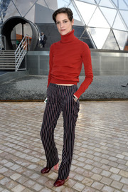 Helene Fillieres cozied up in a red turtleneck for the Louis Vuitton fashion show.