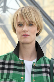 Mackenzie Davis looked funky with her dip-dyed bowl cut at the Louis Vuitton Fall 2019 show.