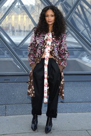 Thandie Newton teamed her top with baggy black slacks.