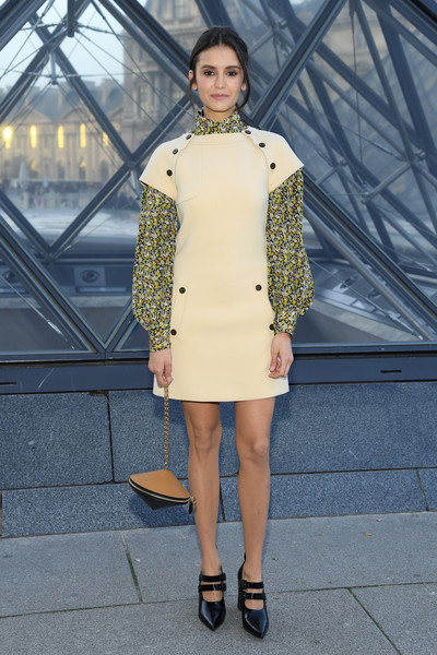 Nina Dobrev looked mod in a Louis Vuitton mini dress with contrast sleeves during the brand's Fall 2019 show.