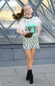 Emma Chamberlain styled her look with black sock boots.