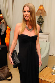 Nicky Hilton toughened her classic sweetheart gown with a black leather satchel style clutch.