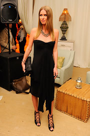 Nicky Hilton topped off her chic black dress with black strappy sandals.
