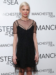 Michelle Williams paired a black Louis Vuitton envelope clutch with a dotted, sheer-overlay LBD for the special screening of 'Manchester by the Sea.'
