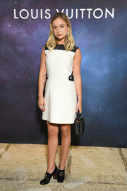 Amelia Windsor styled her frock with black patent loafer heels.