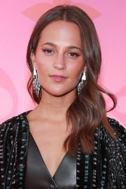 Alicia Vikander looked ultra girly with her side-swept waves at the Louis Vuitton X: An Immersive Journey event.