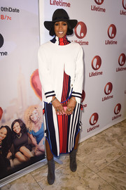 Kelly Rowland teamed her sweater with a matching striped midi skirt.