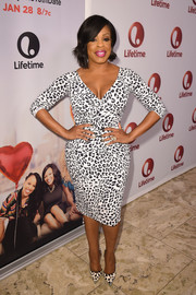 Niecy Nash looked wildly sexy in a low-cut, curve-hugging leopard-print dress at the screening of 'Love by the 10th Date.'