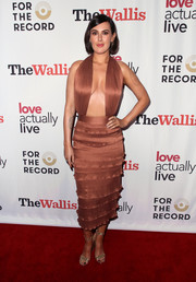 Rumer Willis looked va-va-voom in a bronze halter dress with a down-to-the-waist neckline at the 'Love Actually Live' opening night reception.