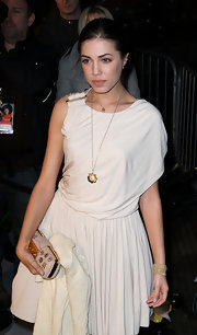 Amber Le Bon opted for gold jewelry, including a cuff bracelet, at the Love Ball in London.