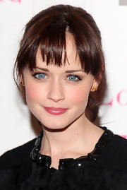 Alexis Bledel resembled a porcelain doll in glossy pink lipstick.