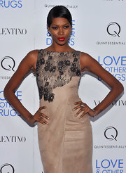 Jessica wore a sleek short 'do to add some drama to her ladylike dress. She finished off the look with bright red lips.