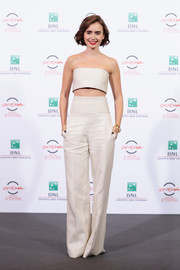 Lily Collins went down the androgynous route in a pair of wide leg pants by Pamella Roland for the 'Love, Rosie' photocall at the 9th Rome Film Festival.