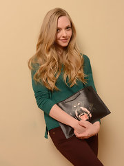 Amanda Seyfried toughened up her look with a Givenchy rottweiler clutch.