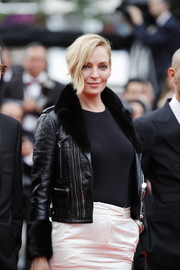 Uma Thurman attended the Cannes Film Festival screening of 'Loveless' wearing a Giuseppe Zanotti croc-embossed leather jacket with a fur collar and cuffs.