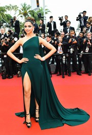 Deepika Padukone looked regal in an emerald Brandon Maxwell one-shoulder gown with a floor-sweeping train at the Cannes Film Festival screening of 'Loveless.'