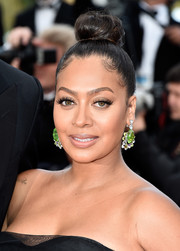 La La Anthony attended the Cannes premiere of 'Loving' wearing her hair in a top bun.