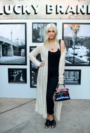 Ashlee Simpson donned a long cream cardigan for a chicer finish to her black tank and jeans at the Lucky Brand Presents Lucky Lives event.
