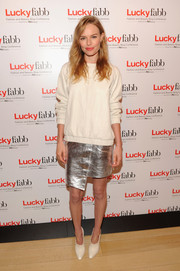 Kate Bosworth added major shine via an asymmetrical silver skirt, also by Topshop.