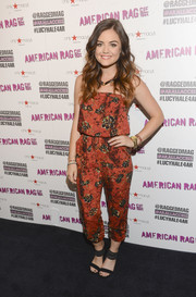 Lucy Hale chose a pair of black ankle-cuff sandals, also by American Rag, to team with her jumpsuit.