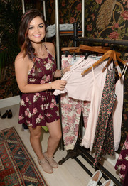 Lucy Hale was cute and girly during her concert in a floral romper from her own Hollister collection.