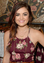Lucy Hale looked super cute with her red-streaked loose braid during her Hollister House performance.