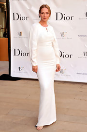 Uma Thurman's solid white long-sleeve gown gave her an ethereal look at the American Ballet Spring Gala in NYC.