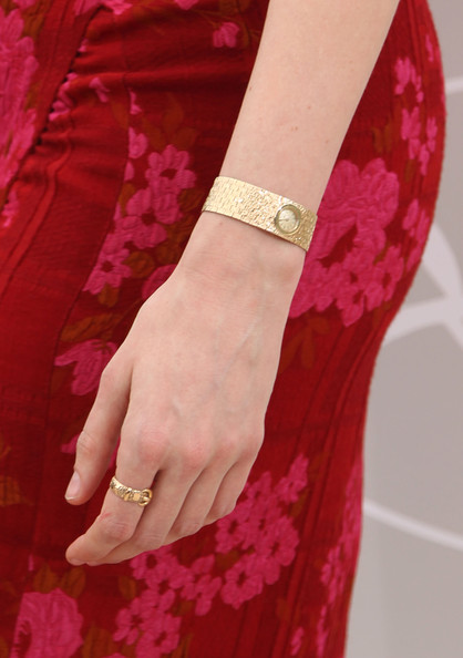 Lucy Punch Gold Bracelet Watch [you will meet a tall dark stranger - photocall,you will meet a tall dark stranger,pink,red,magenta,bangle,jewellery,maroon,bracelet,fashion,arm,fashion accessory,lucy punch,jewellery detail,photocall,cannes,france,cannes film festival,annual cannes film festival,palais des festivals]