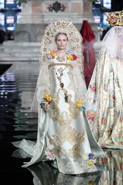 Natasha Poly looked opulent in an embroidered wedding gown by Christian Lacroix at the LuisaViaRoma CR runway show.
