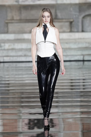 Gigi Hadid opened the LuisaViaRoma CR runway show wearing a fitted, tux-inspired white top by Karl Lagerfeld.