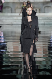 Irina Shayk was classic in a black pinstriped skirt suit by Mugler at the LuisaViaRoma CR runway show.
