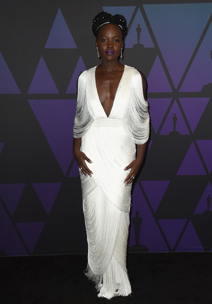 Lupita Nyong'o Fringed Dress [white,clothing,dress,fashion,fashion model,gown,beauty,fashion design,neck,haute couture,lupita nyongo,hollywood highland center,california,the ray dolby ballroom,academy of motion picture arts and sciences,10th annual governors awards,governors awards]
