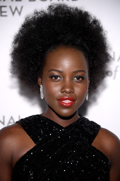 Lupita Nyong'o Red Lipstick [hair,hairstyle,face,afro,jheri curl,black hair,lip,beauty,human,s-curl,arrivals,lupita nyongo,new york city,cipriani 42nd street,the national board of review annual awards gala,national board of review annual awards gala,lupita nyongo,star wars forces of destiny,celebrity,fashion,beauty,model,supermodel,the national board of review]