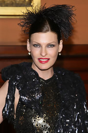 Linda Evangelista applied a vivid blue-based red lipstick for the 2012 Lycee Francias de New York Gala.