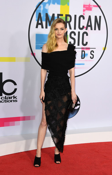 Lydia Hearst Off-the-Shoulder Dress [photo,clothing,red carpet,dress,carpet,shoulder,little black dress,fashion,flooring,footwear,joint,arrivals,lydia hearst,mark ralston,american music awards,california,los angeles,afp]