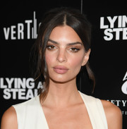 Emily Ratajkowski styled her hair into a loose bun for the New York screening of 'Lying and Stealing.'