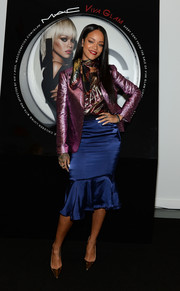 Rihanna gleamed in a metallic purple Lanvin blazer during the launch of her MAC Viva Glam collection.