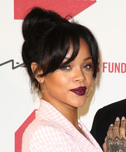 Dark red lipstick added a goth touch to Rihanna's look.