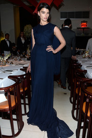 Crystal Renn exuded dramatic elegance in a caped blue gown by Zac Posen during the designer's pre-fall collection celebration.