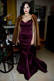 Dita Von Teese was heartstoppingly gorgeous in a plum-colored mermaid gown by Zac Posen during the designer's pre-fall collection celebration.