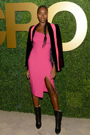 Damaris Lewis showed off her svelte physique in a fitted hot-pink one-shoulder dress by Likely at the MACRO pre-Oscar party.