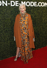 Maye Musk topped off her dress with an ochre coat.