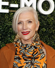 Maye Musk made a bold statement with those oversized gold chandelier earrings.