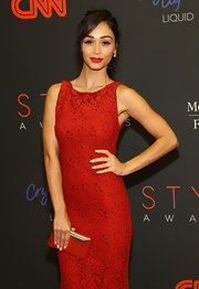 Cara Santana's gold hard-case clutch and red evening dress at the Style Awards were a sophisticated pairing.