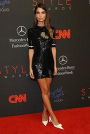 Lily Aldridge matched her dress with a pair of funky white pointy pumps.