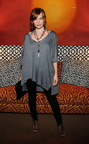 Actress Milla Jovovich wore a v-neck tunic in dark heather grey while hosting the Mercedes-Benz Afternoon Tea in celebration of New York Fashion Week.