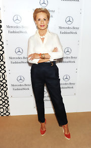 Carolina Herrera added a splash of color to her ensemble with a pair of red wedges.