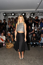 Lara Bingle paired her crop top with this crisp box pleat A-line skirt at the Ellery fashion show.